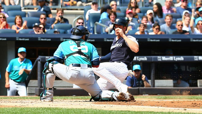 Aug 26, 2017; Bronx, NY, USA; New York Yankees first baseman Greg Bird (33) is tagged out at home plate by Seattle Mariners catcher Carlos Ruiz (52) during the second inning at Yankee Stadium. Mandatory Credit: Andy Marlin-USA TODAY Sports
