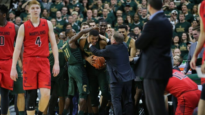 Michigan State coach Tom Izzo celebrates with Xavier Tillman, center, in the first half against Maryland at Breslin Center on Jan. 4, 2018 in East Lansing.