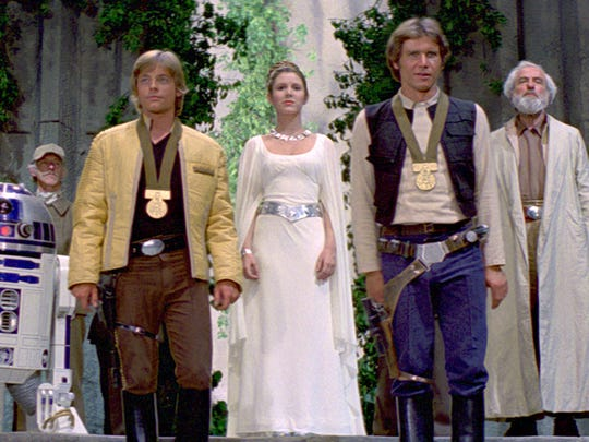 Mark Hamill as Luke Skywalker, Carrie Fisher as Princess Leia and Harrison Ford as Han Solo in the original 1977 'Star Wars' film.