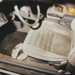 This photograph shows the inside of the Oldsmobile that Paige Renkoski was driving when she disappeared from the shoulder of westbound Interstate 96, about one-quarter of a mile east of the Fowlerville exit, on May 24, 1990. The car was found still running and her shoes and purse inside.