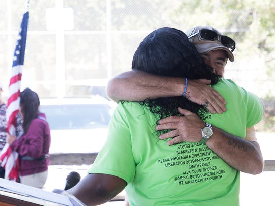 Tim Byrne, CEO of Aqua Consultants gets a hug from Charleston Park resident coordinator LaShay Russ during Charleston Park Day on Saturday 4/28/2018. Byrne has been volunteering his time to install  water filtering systems in residents' homes. Clean Water for Charleston Park, a project of Blankets and Blessings was also honored for helping with the water issues that have plagued the community for decades.