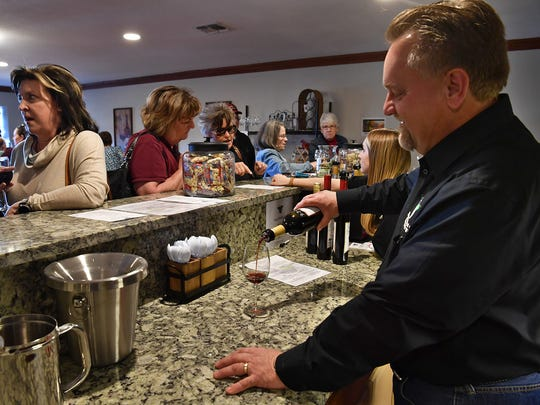 Scott Poenitzszh, owner and general manager of Horseshoe Bend Cellars Vineyard and Winery, pours a glass of wine during the grand opening two years ago. The business is located on Peterson Road and was formerly Wichita Falls Vineyard and Winery.