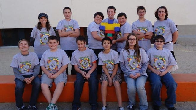 Silverland Middle School's Guardians of the Bricks LEGO robotics team have been invited to enter the first LEGO League competition to be held April 22 to 25 in St. Louis, Mo. Shown are (back row) Mrs. Aiello, Riley Kitchens, Roman Porterfield, Brian Capps, Hunter Porterfield, Conor Gibson, Mrs. Speth and (front row) Slater Aiello, Dominic Gianotti, Wyatt Shaw, Michael Rivera, Kennedy Lyon and Evan Perry.