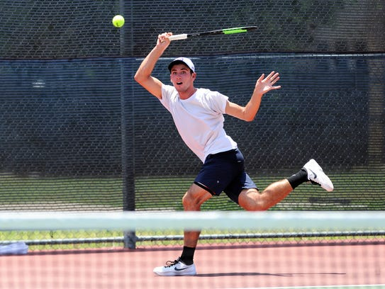 Wylie's Lane Adkins follows his shot during the fourth-round qualifier of the Boys' 18 USTA Texas Slam consolation bracket at Craig Middle School on Tuesday. Adkins won 4-6, 6-1, 11-9.