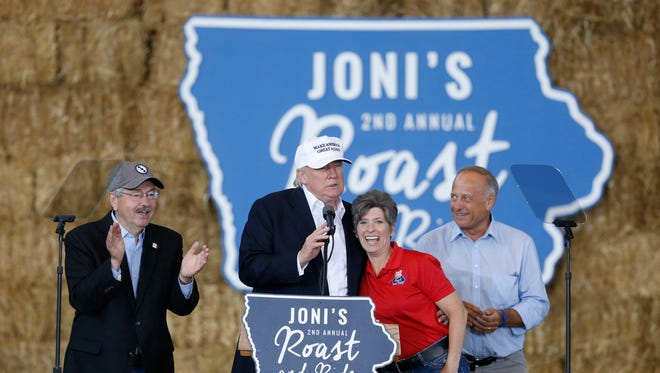 Gov. Terry Branstad joins Republican presidential candidate Donald Trump on stage along side Sen. Joni Ernst and Rep. Steve King during the second annual Roast and Ride at the Iowa State Fairgrounds in 2016.