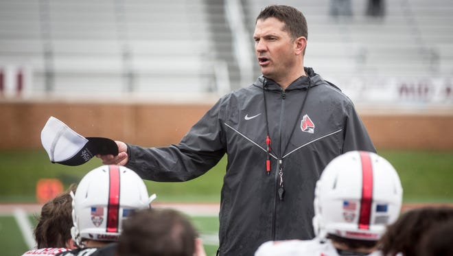 Ball State's Mike Neu talks to the team after the annual spring game on April 14 at Scheumann Stadium.