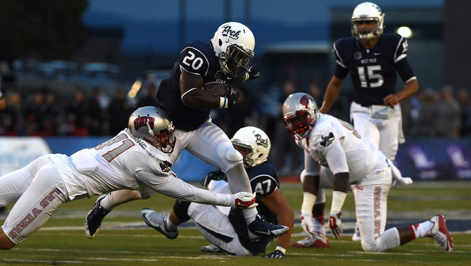 Nevada's James Butler tries to gat past UNLV's Troy