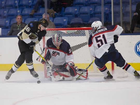 During a recent preseason game, U17 goalie Keegan Karki stops the puck with help from defenseman Will MacKinnon, a Plymouth resident.