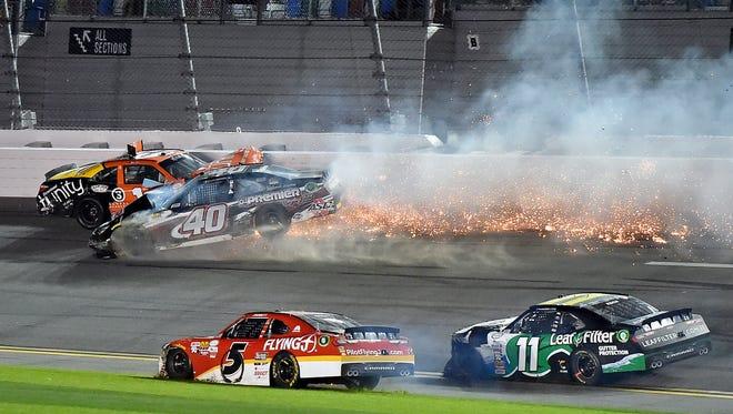 NASCAR Xfinity Series driver Matt Tifft (19) and NASCAR Xfinity Series driver Brandon Hightower (40) wreck during the PowerShares QQQ 300 at Daytona International Speedway.
