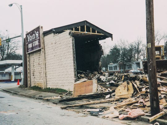 A family photo of the demolition of Yon's Grocery in Anderson around 1996.