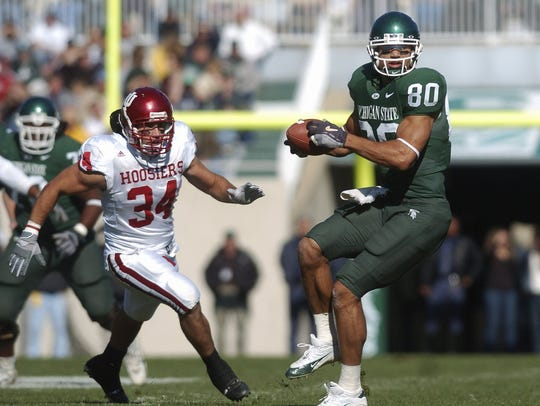 MSU's Kellen Davis turns to run after connecting with