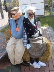 "This ""elderly couple"" scarecrow is among the collection"