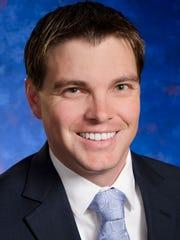 Travis J. Smith