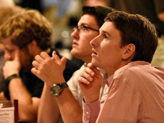CJ Weigle, front, and Jacob Taylor, both of Windsor Township, watch updates as they wait for Donald Trump to speak during a GOP watch party at Stone Grille & Taphouse in York Township, Thursday, July 21, 2016. Dawn J. Sagert photo
