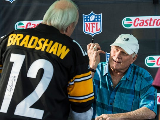Terry Bradshaw, Hall of Fame quarterback, former Pittsburgh Steelers quarterback and co-host of Fox NFL Sunday, greets Bob Heisey of North Lebanon Township who has been a Steelers fan for 55 years as hundreds of people lined up to see him at Advance Auto Parts in Myerstown on Tuesday, Oct. 11, 2016. The store was the top seller of Castrol products in one of the company's three regions in July and August and was rewarded with a tailgate and Bradshaw appearance.