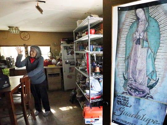 Gloria Gonzales Ramirez, 67, talks in the kitchen of