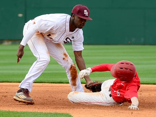 Sacred Heart's Kylon Holder tags Bradford's Blaine Cunningham out at second base during their game, Friday, March 24. Sacred Heart defeated Brandford, 10-1.