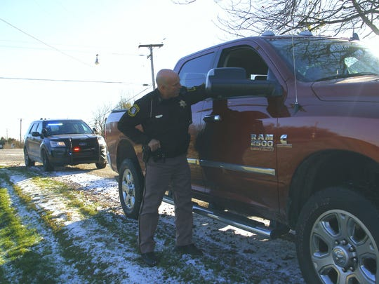 St. Clair County Sheriff's Deputy Jeff Green talks with a driver he pulled over off of Capac Road on Friday, Nov. 10, 2017. He is the only law enforcement officer for the county whose position is entirely grant-funded as part of a secondary road patrol program.