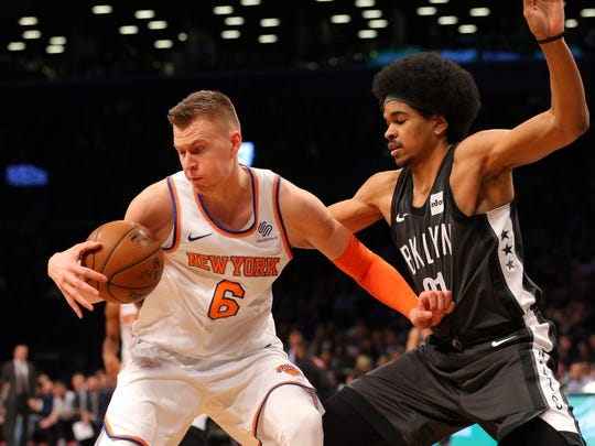 New York Knicks power forward Kristaps Porzingis (6) plays the ball against Brooklyn Nets center Jarrett Allen (31) during the first quarter at Barclays Center.