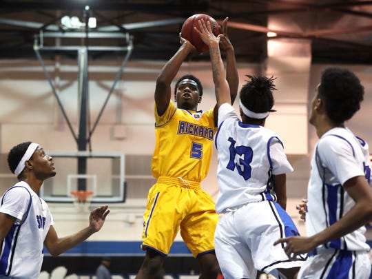 Rickards' Vincent McCray shoots over Godby's Kendric