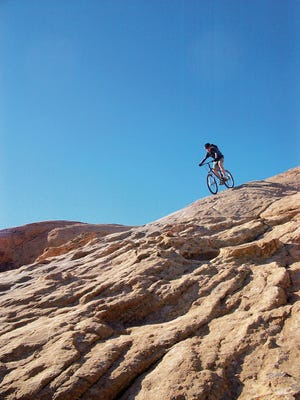 A San Juan College student practices mountain bike handling skills in 2009 in Moab, Utah, through the school's outdoor leadership, education and recreation program.