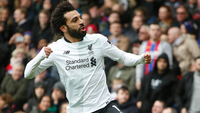 Liverpool's Mohamed Salah celebrates after scoring his side's second goal.
