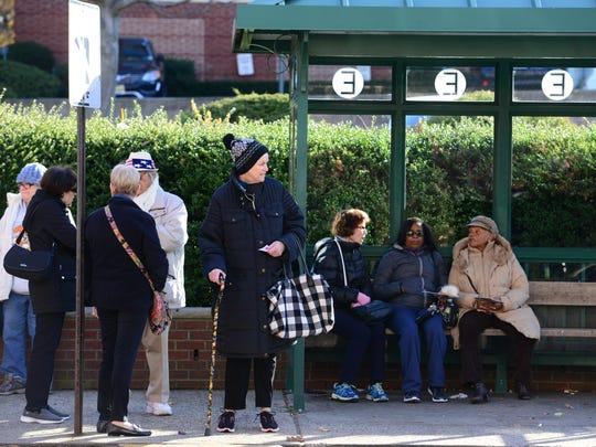 A group of senior citizens wait for the 756 NJ Transit bus in Englewood to take them to Garden State Plaza on Tuesday morning.