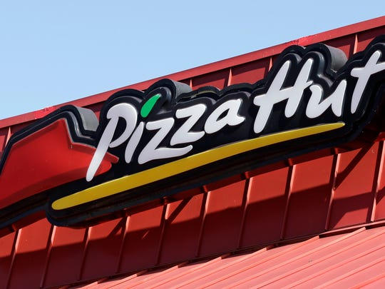 Pizza Hut tests out delivering beer to customers in the Phoenix area and plans to start delivering wine in January.