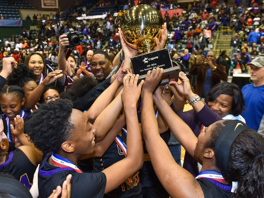 Hattiesburg players hoist the trophy following their win over West Jones in the MHSAA Girls 5A Championship Game held at The Coliseum in Jackson.