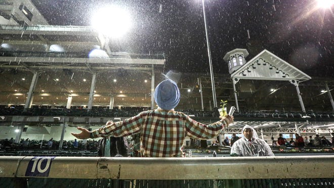 10:46 pm: Devinder Sandhu, of Nashville, turned to the heavens and taunted the heavy rain falling at Churchill Downs on opening night.