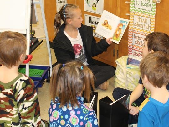 Sophia Paape from Horace Mann reads to students at