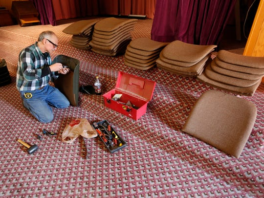 Jerry Day with Kim's Upholstery Shop replaces the cushions of original stadium chairs inside the auditorium Thursday, April 12, 2018, of the former Masonic Temple at the corner of Sixth and Columbia streets in downtown Lafayette. The building was purchased by the Tippecanoe County Historical Association in January of 2017. The TCHA is renovating the building and will offer it as an event venue and also use it for curatorial space. Day formerly served as operations manager, assistant director and interim director of the TCHA.