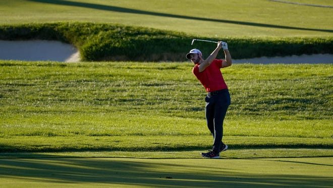 Matthew Wolff hits from just off the 18th fairway during the third round of the U.S. Open on Saturday.