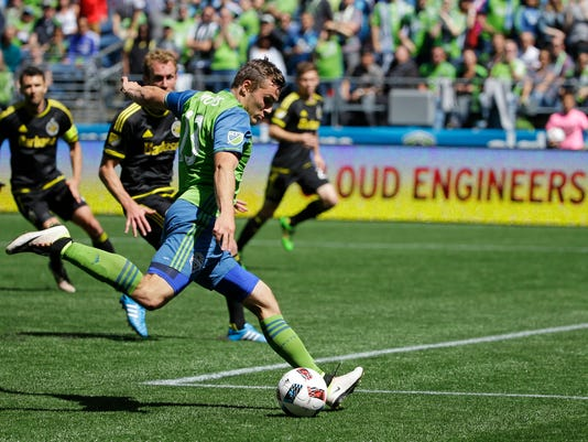 Seattle Sounders' Jordan Morris makes a shot on goal against the Columbus Crew in the second half of an MLS soccer match, Saturday, April 30, 2016, in Seattle. The Sounders beat the Crew 1-0. (AP Photo/Ted S. Warren)
