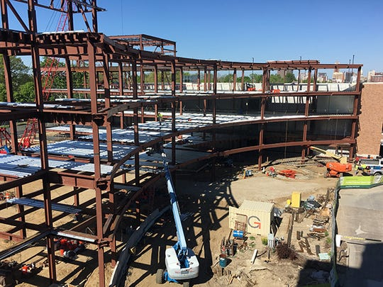 The steel framing of the Herbert-Herman Cancer Center was completed in June 2016