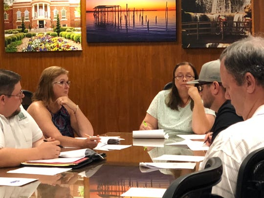 Some members of the Lake Wichita Revitalization Committee are seen Tuesday, headed by interim chairman Penny Miller, center back. Miller was nominated for the temporary position until a chairman candidate is chosen.