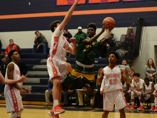 Mardela's Brian Kellam drives towards the basket against