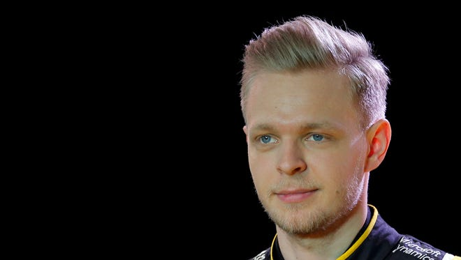 Kevin Magnussen poses during the presentation of the Renault R.S.16 at the Renault's technocentre west of Paris.