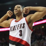 Mar 26, 2016; Portland, OR, USA; Portland Trail Blazers guard C.J. McCollum (3) shows his muscles after making the winning basket over the Philadelphia 76ers at Moda Center at the Rose Quarter. Mandatory Credit: Jaime Valdez-USA TODAY Sports