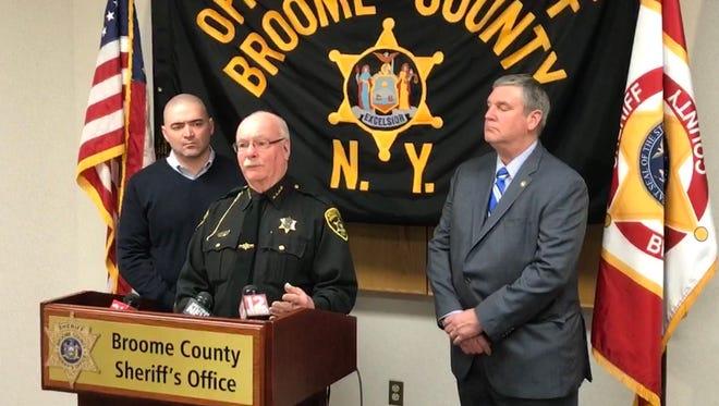 Broome County Sheriff David Harder, center, Sen. Fred Akshar, left, and Broome County Clerk Joseph Mihalko seek a delay of the pistol permit re-certification deadline.