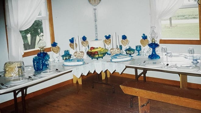 Tables decorated for Lovina and Joe Eicher's wedding in 1993. Photo provided