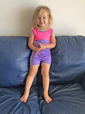 Isabella gets ready for her first gymnastics class in her new leotard.