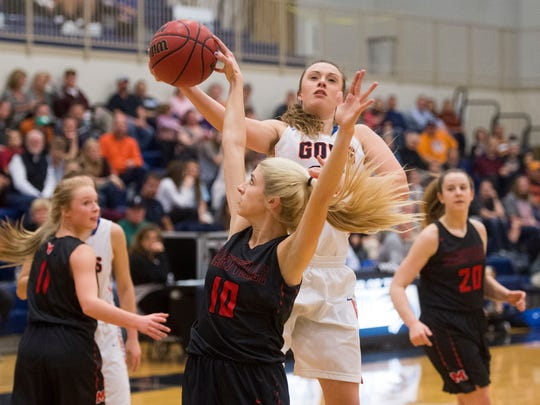 William Blount's Abbi Joseph is defended by Maryville's Abbie Anderson in the District 4-AAA girls basketball tournament championship game at Hardin Valley Academy on Monday, February 20, 2017. Maryville defeated William Blount, 71-45.