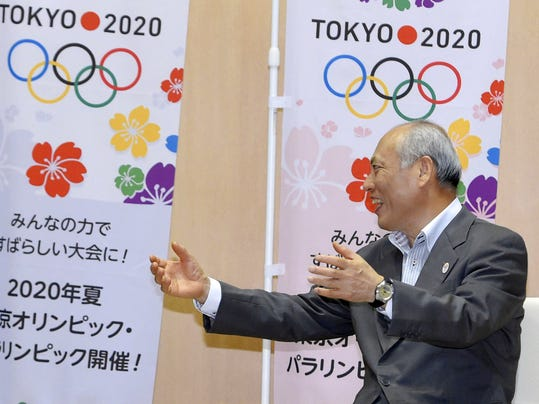 In this  July 22, 2015 photo, Tokyo Gov. Yoichi Masuzoe gestures while talking with Olympics Minister Toshiaki Endo at Tokyo Metropolitan Government office in Tokyo. Preparations for the 2020 Olympics were set back again when Masuzoe submitted his resignation Wednesday, June 15, 2016, ending a weeks-long bid to stay in power despite a mounting scandal over his alleged use of political funds for personal purposes. Masuzoe had been scheduled to attend the Rio Olympics opening ceremony in August, and would have accepted the Olympic flag during a handover at the closing ceremony. (Kyodo News via AP) JAPAN OUT, MANDATORY CREDIT