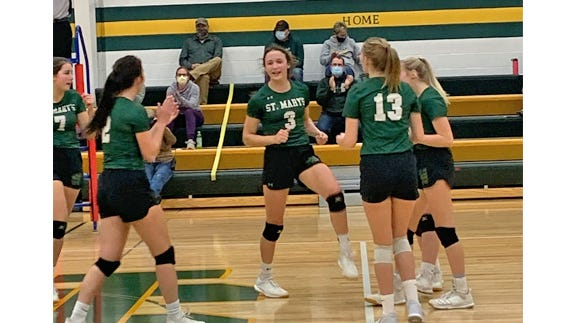 Celebrating a Knights' point in the game against GFW, are from left: Emily Weiss, Sydney Windschitl, Madison Mathiowetz, Jaci Domeier and Reagan Severson.
