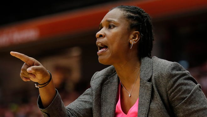 Cincinnati Bearcats head coach Jamelle Elliott instructs the team in the second half.