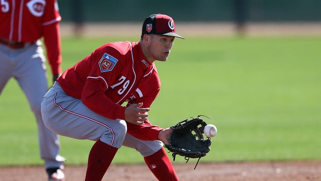 Cincinnati Reds third baseman Nick Senzel (79) fields a groundball, Tuesday, Feb. 20, 2018, at the Cincinnati Reds Spring Training facility in Goodyear, Arizona.
