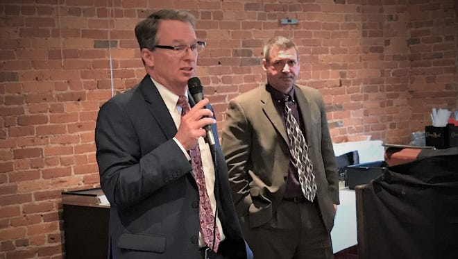 Patrick Harrington and Earl McCoy, candidates for Tippecanoe County prosecutor, spoke with their colleagues Thursday during the Tippecanoe County Bar Association meeting.