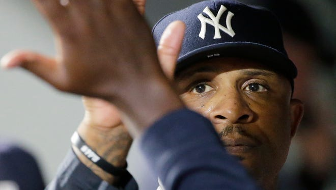 New York Yankees starting pitcher CC Sabathia is greeted in the dugout after he finished the seventh inning of a baseball game against the Seattle Mariners, Tuesday, Aug. 23, 2016, in Seattle.