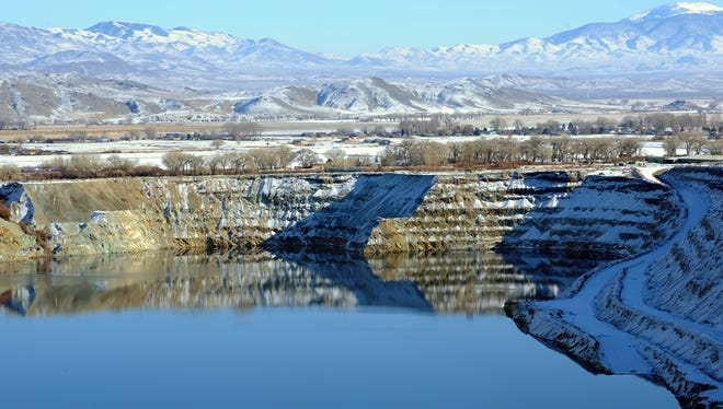 The old Anaconda mine pit is partially filled with water near Yerington. The U.S. Environmental Protection Agency will host a community meeting on Aug. 26 to discuss the mine.